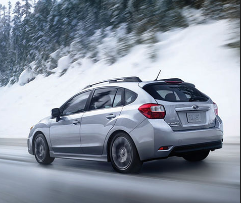 Subaru driving in cold weather on snowy roads